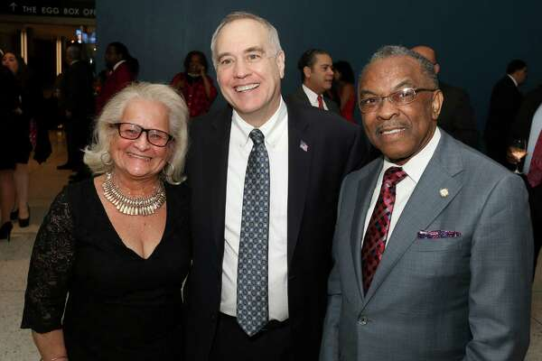 Albany, NY - February 19, 2017 - (Photo by Joe Putrock/Special to the Times Union) - New York State Comptroller Thomas P. DiNapoli(center) poses with Nellie Gonzalez-Arce(left) and Solomon Dees(right) during the New York State Black & Puerto Rican Caucus gala at the Empire State Plaza Convention Center. ORG XMIT: 04