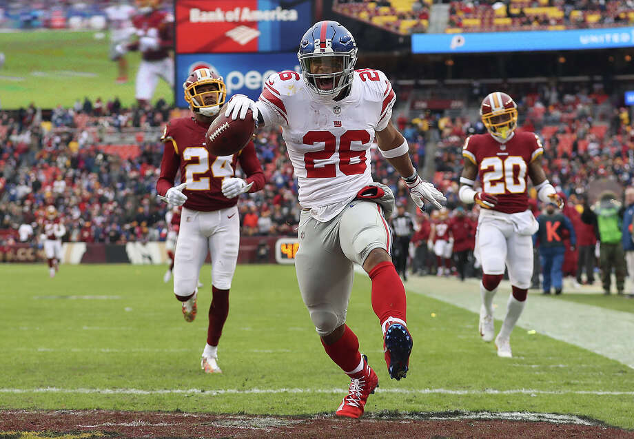 LANDOVER, MD - DECEMBER 09: Running back Saquon Barkley #26 of the New York Giants rushes for a 78-yard touchdown in the second quarter against the Washington Redskins at FedExField on December 9, 2018 in Landover, Maryland. (Photo by Patrick Smith/Getty Images) *** BESTPIX *** Photo: Patrick Smith / 2018 Getty Images