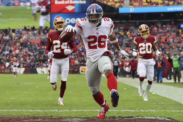 LANDOVER, MD - DECEMBER 09: Running back Saquon Barkley #26 of the New York Giants rushes for a 78-yard touchdown in the second quarter against the Washington Redskins at FedExField on December 9, 2018 in Landover, Maryland. (Photo by Patrick Smith/Getty Images) *** BESTPIX ***