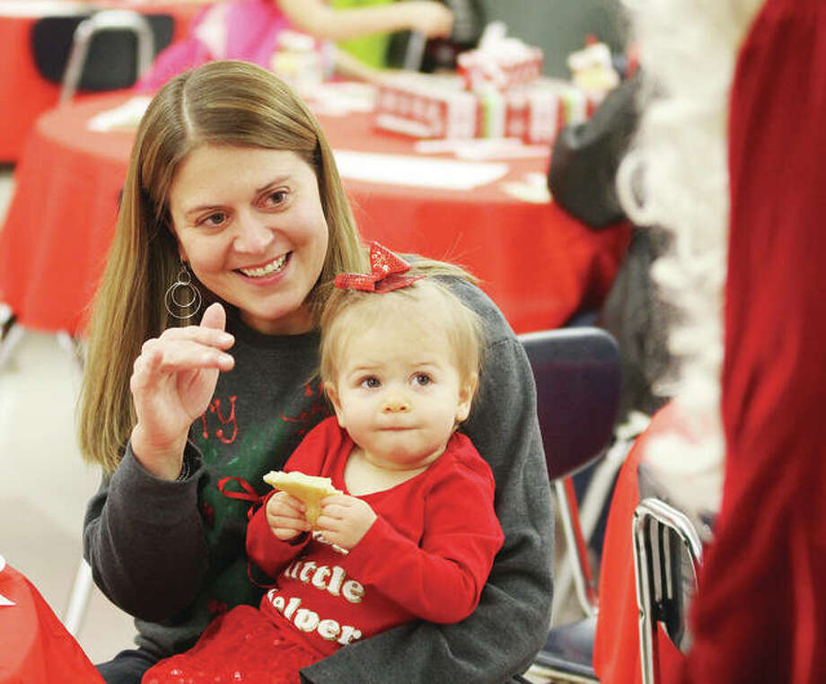 Kennedy Pinkas, 17 months, and her mother, Meghan Pinkas, of Glen Carbon, look over Santa at Woodland Elementary Schools annual Breakfast with Santa, held Saturday. The event, a fundraiser for the American Cancer Society's Relay for Life program, brings in about 700 children who get breakfast, a chance to visit with Santa, and participate in crafts and other activities. Photo: Scott Cousins | The Telegraph