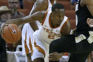 AUSTIN, TX - DECEMBER 9: Matt Coleman III #2 of the Texas Longhorns drives against the Purdue Boilermakers at the Frank Erwin Center on December 9, 2018 in Austin, Texas. (Photo by Chris Covatta/Getty Images)