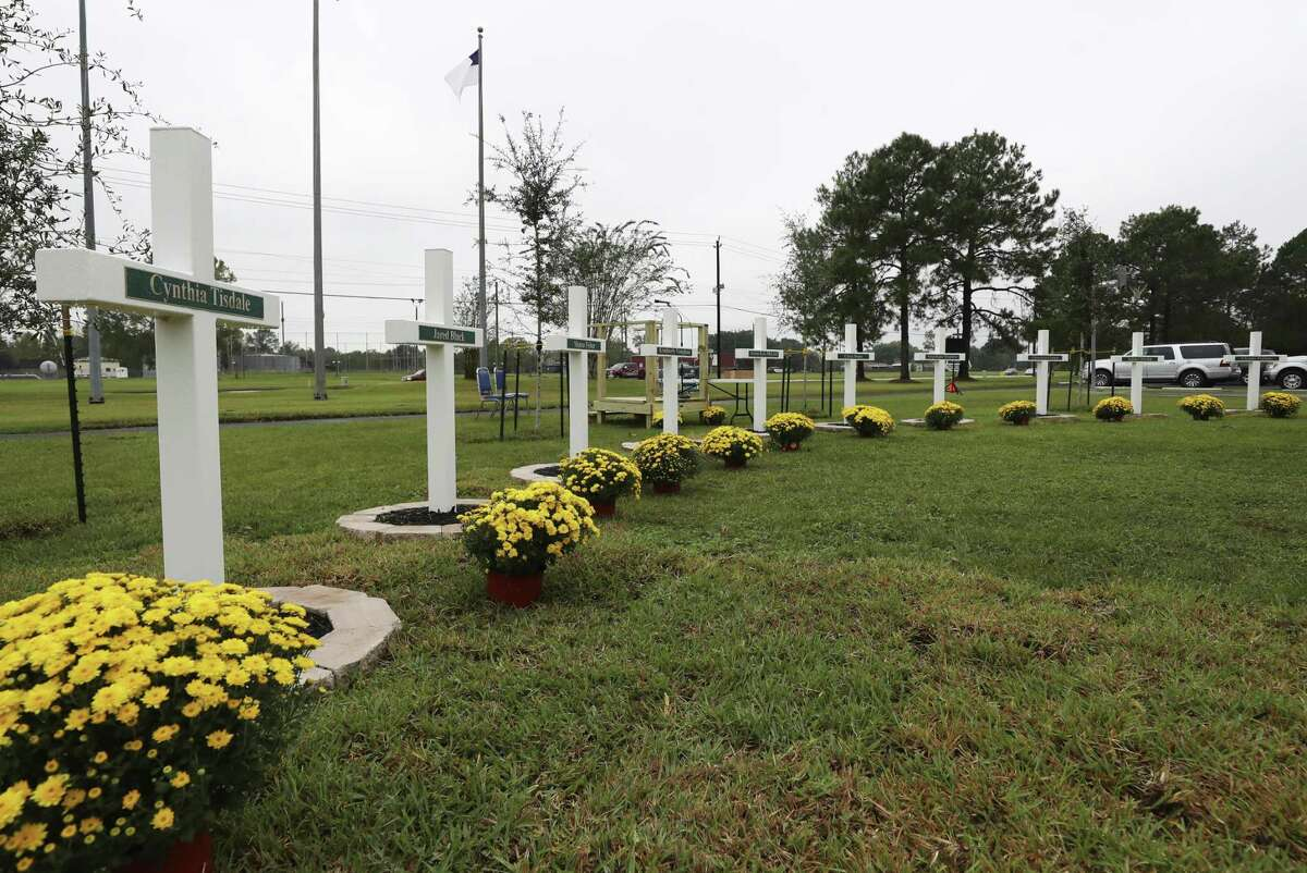 In this Saturday, Oct. 20, 2018 photo, ten crosses honoring the 10 people killed in a shooting at Santa Fe High School were dedicated during a ceremony at Maranatha Christian Center in Santa Fe, Texas. (Kelsey Walling/The Galveston County Daily News via AP)