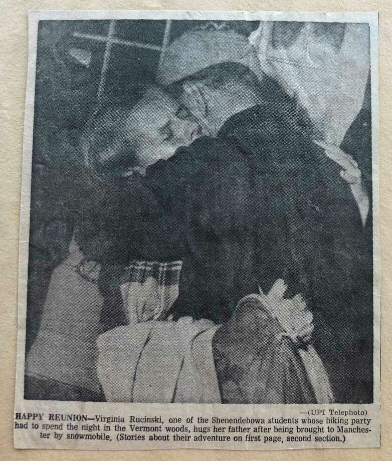 Scrapbook photo of Ginny Rucinski Charbonneau hugging her father after being rescued with members of her hiking club. Twenty students and two teachers spent the night in a brutal 1968 snowstorm while hiking in the Green Mountains of Vermont. Dec. 16 marks the 50th anniversary of the rescue. (UPI photo) Photo: Times Union, Joyce Bassett