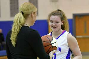 Saratoga Head Coach Robin Chudy gives Kerry Flaherty a personalized basketball after she made her 1,000th career point during a basketball game against Colonie on Tuesday, Dec. 4, 2018 in Saratoga Springs, N.Y. (Lori Van Buren/Times Union)