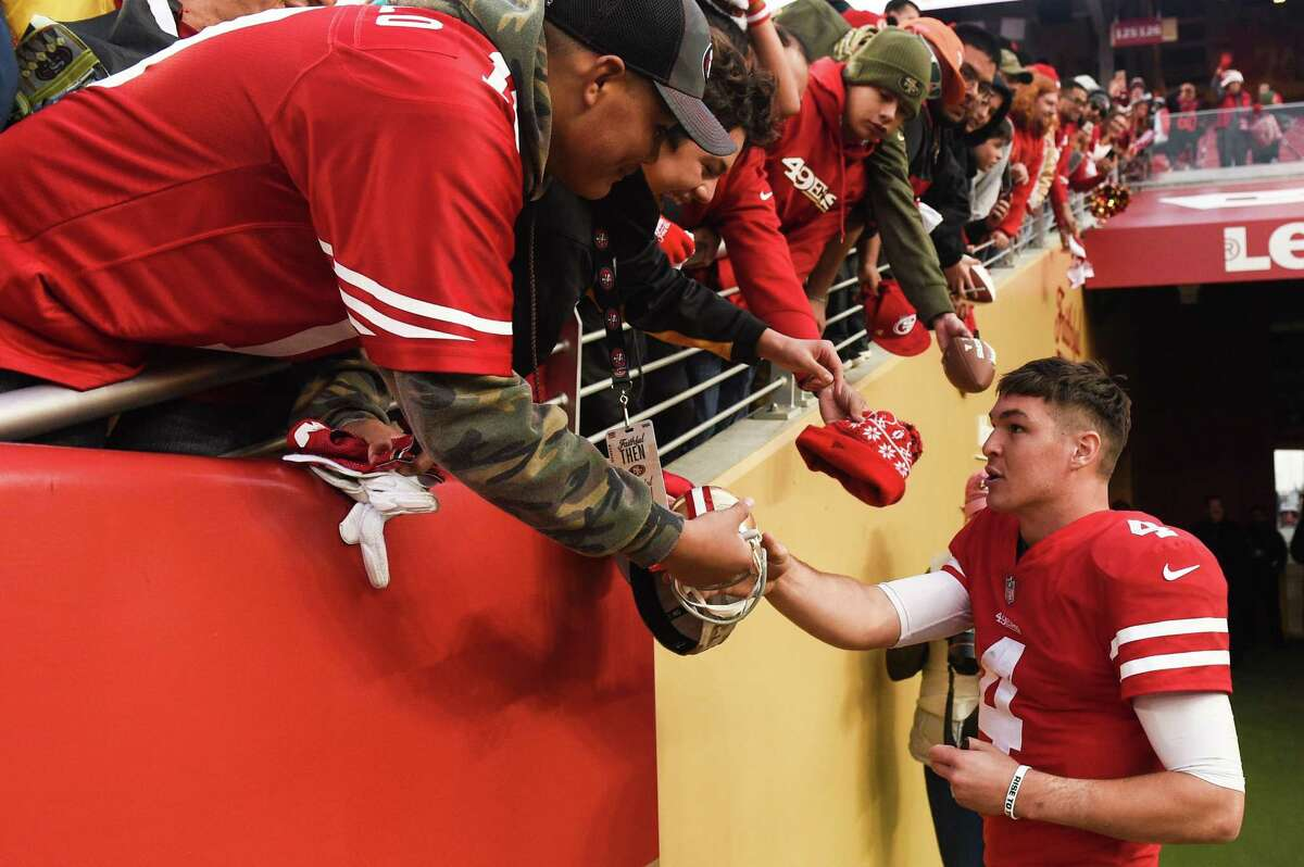 SANTA CLARA, CA - DECEMBER 09: San Francisco 49ers Quarterback Nick Mullens (4) signs autographs after the NFL football game between the Denver Broncos and the San Francisco 49ers on December 9, 2018 at Levi's Stadium in Santa Clara, CA. (Photo by Cody Glenn/Icon Sportswire via Getty Images)