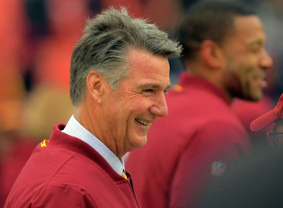 Bruce Allen, Redskins team president, shares a laugh before Sunday's game against the Giants. The 40-16 loss left Washington 58-82-1 during Allen's nine-year tenure. Photo: Washington Post Photo By John McDonnell / The Washington Post