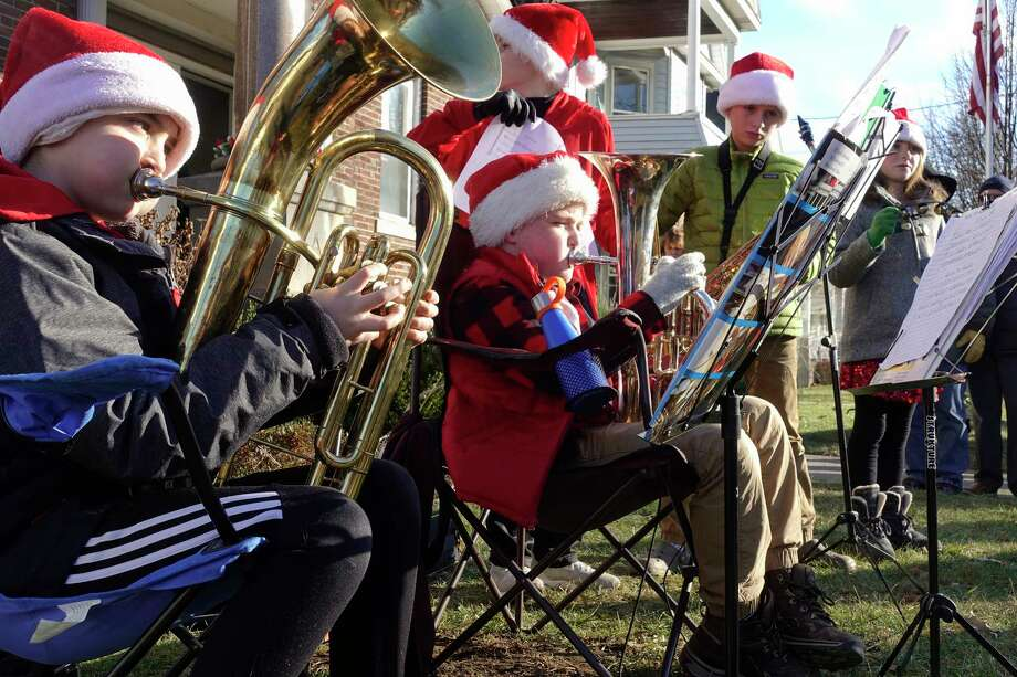 Guilderland School District students, from left to right, Elijah Kowalski, Braeden Gutowski, Conner Walsh, Thatcher Martin and his sister Josie Martin perform holiday songs outside at the Altamont Community Tradition (ATC) Victorian Holidays event on Sunday, Dec. 9, 2018, in Altamont, N.Y.   (Paul Buckowski/Times Union) Photo: Paul Buckowski / (Paul Buckowski/Times Union)
