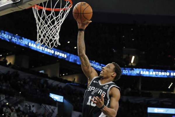 DeMar DeRozan #10 of the San Antonio Spurs scores two . Utah Jazz v San Antonio Spurs on Sunday, December 9, 2018 at the AT&T Center.