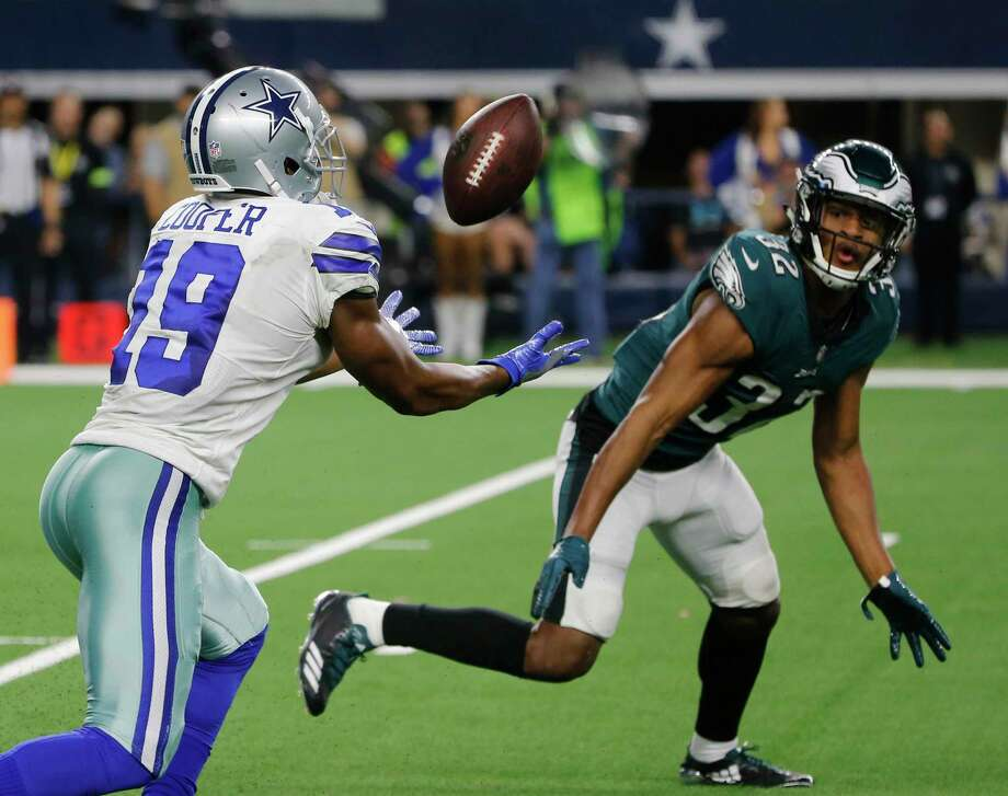 Dallas Cowboys wide receiver Amari Cooper (19) makes a 15-yard catch in front of Philadelphia Eagles cornerback Rasul Douglas (32) for a touchdown in overtime of an NFL football game, in Arlington, Texas, Sunday, Dec. 9, 2018. (AP Photo/Michael Ainsworth) Photo: Michael Ainsworth / Copyright 2018 The Associated Press. All rights reserved.
