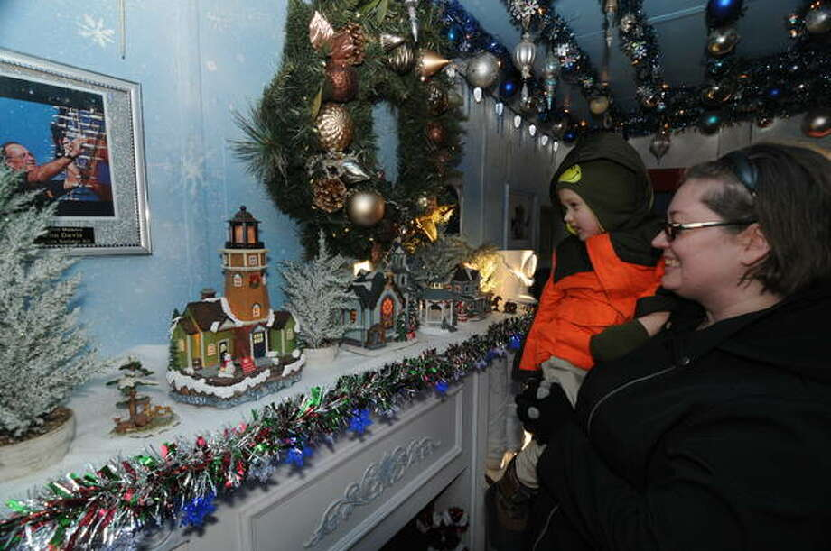"""Children and adults alike """"ooh"""" and """"ahh"""" at the displays inside the KCS Holiday Express. Photo: David Blanchette   For The Telegraph"""