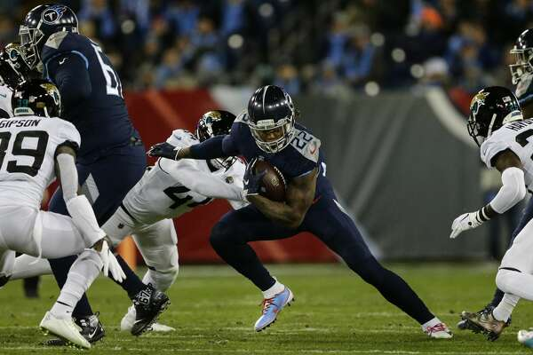 NASHVILLE, TN - DECEMBER 6: Derrick Henry #22 of the Tennessee Titans runs downfield with the ball against the Jacksonville Jaguars during the fourth quarter at Nissan Stadium on December 6, 2018 in Nashville, Tennessee. (Photo by Silas Walker/Getty Images)