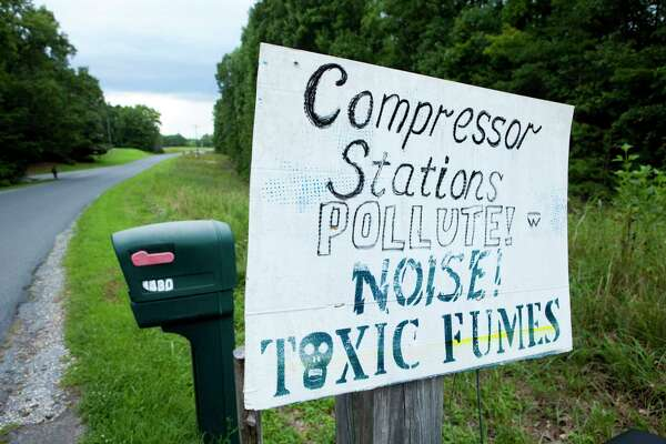 Signs adorn mailboxes in Yogaville, Virginia, in protest of the construction of a nearby natural-gas-pipeline facility.