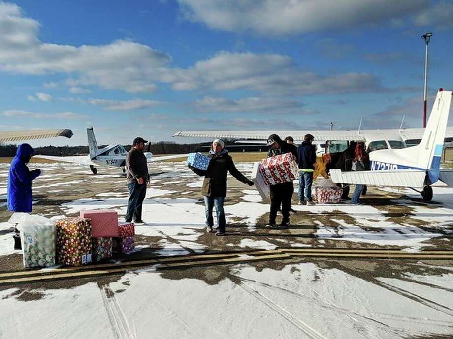 Nine planes, packed with presents to be donated to Midland's Adoption Option and Gladwin County Department of Health and Human Services, flew into Gladwin Zettel Memorial Airport Saturday afternoon. (Tereasa Nims/for the Daily News)