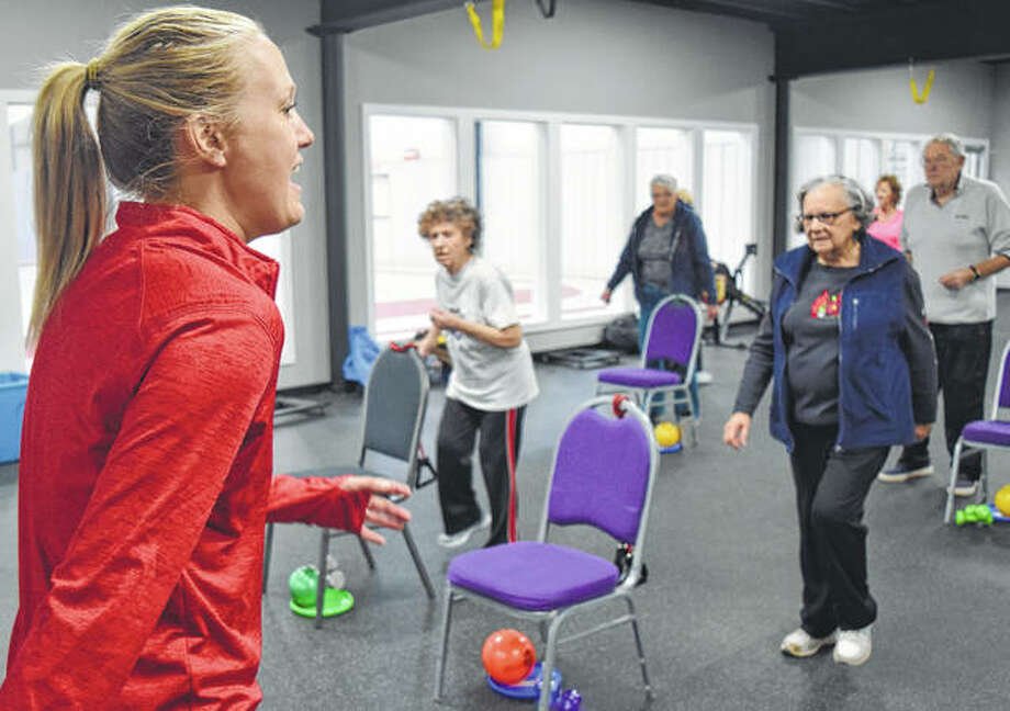 Rachel Rohn, owner of Fitness World, leads a SilverSneakers class on Friday.
