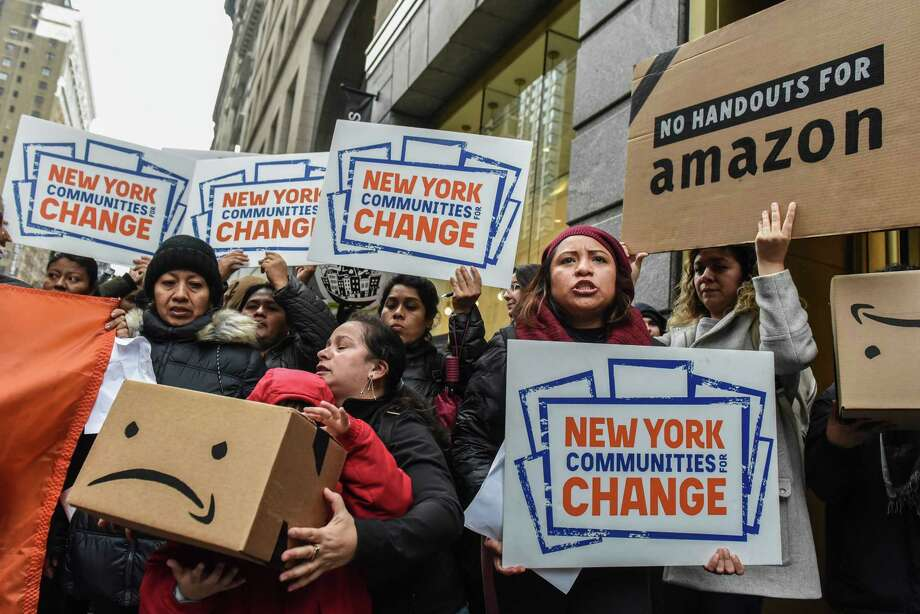 NEW YORK, NY - NOVEMBER 26: People opposed to Amazon's plan to locate a headquarters in New York City hold a protest inside of an Amazon book store on 34th. St. on November 26, 2018 in New York City. Amazon recently announced that New York City will become one of two locations that will house Amazon's second North American headquarters, known as HQ2. (Photo by Stephanie Keith/Getty Images) Photo: Stephanie Keith / 2018 Getty Images