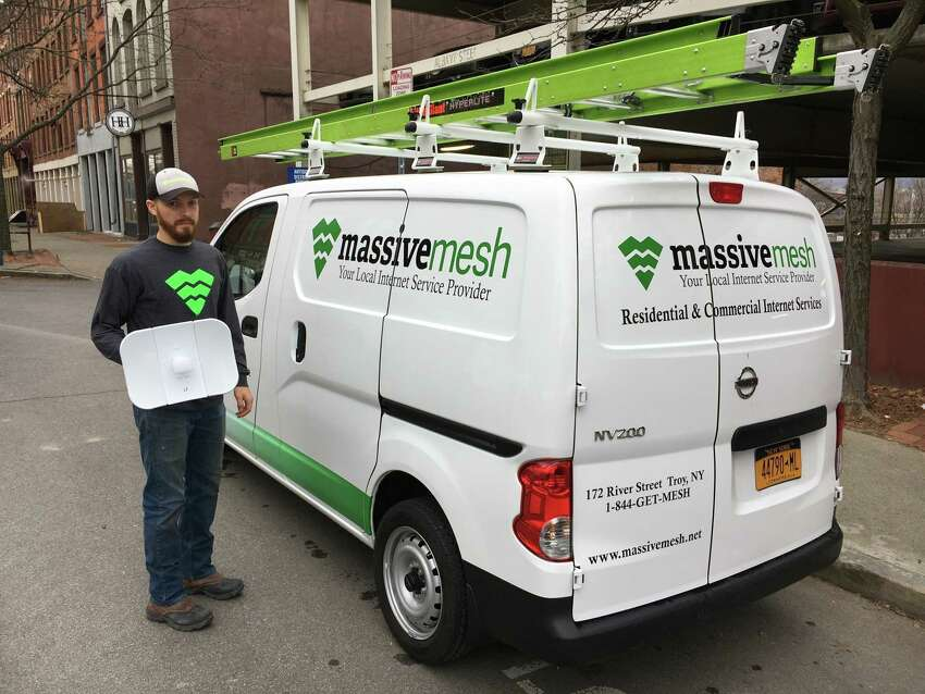 A Massive Mesh technician shows off one of the company's radio receivers used in its wireless broadband network in the Capital Region.