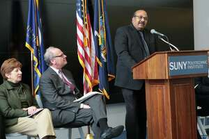 """Omkaram """"Om"""" Nalamasu, the chief technology officer at Applied Materials, speaks during an announcement back in November. Seated next to him is Howard Zemsky, CEO of Empire State Development, and Albany Mayor Kathy Sheehan."""