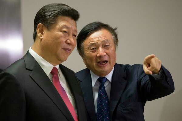 Xi Jinping, China's president (left) pauses as he is shown around the offices of Huawei Technologies Co by Ren Zhengfei, billionaire and president of Huawei Technologies Co., in London on Oct. 21, 2015.