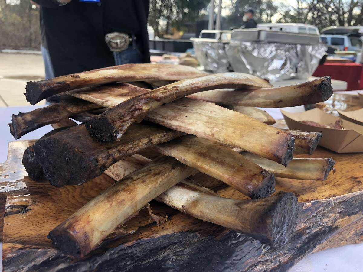 PHOTOS: Austin and Houston barbecue duke it out Texas Jenga: A pitmaster at theHOU-ATX BBQ Throwdown 2018 used rib bones to decorate his booth at Friends and Allies Brewing Company in Austin on Sunday. >>>See more photos from the meaty event...