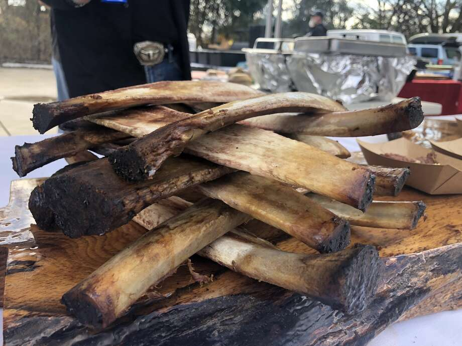 PHOTOS: Austin and Houston barbecue duke it out Texas Jenga: A pitmaster at theHOU-ATX BBQ Throwdown 2018 used rib bones to decorate his booth at Friends and Allies Brewing Company in Austin on Sunday.   >>>See more photos from the meaty event... Photo: Craig Hlavaty