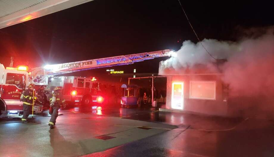 Crews fight a fire at Elephant Car Wash in the 12800 block of Bel Red Road in Bellevue. Photo: Courtesy Bellevue Fire