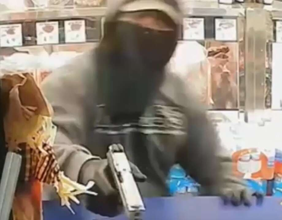 Police are searching for three armed men who robbed eight people at a Spring Branch area meat market on Nov. 20. Photo: Houston Police Robbery Division