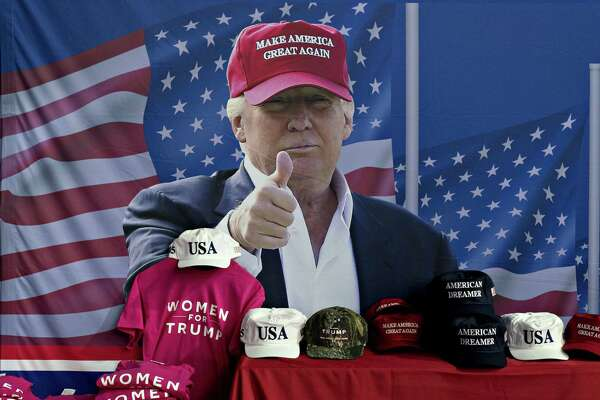 A banner featuring an image of U.S. President Donald Trump is seen near a table with official campaign merchandise during a 2018 rally in Washington, Mich.