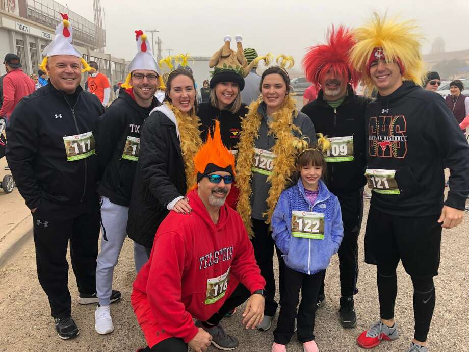Turkey Trot: Dal Watson, back row from left, Will Watson, Melanie Julian, Connie Watson, McKaleigh Watson, Zane Waton and Landry Watson; and Nolan Watson, front row left, and Lucy Watson Photo: Courtesy Photo
