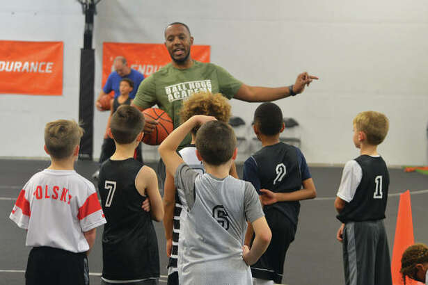 Brandon Hogg, a 2008 graduate of Edwardsville High School, works with young basketball players during a practice at Ball Hogg Academy. Hogg is CEO and founder of the academy, which opened in February 2017 and moved to its current location in April.