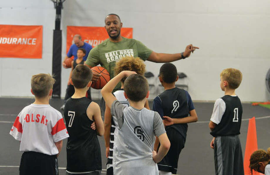 Brandon Hogg, a 2008 graduate of Edwardsville High School, works with young basketball players during a practice at Ball Hogg Academy. Hogg is CEO and founder of the academy, which opened in February 2017 and moved to its current location in April. Photo: Scott Marion/Intelligencer