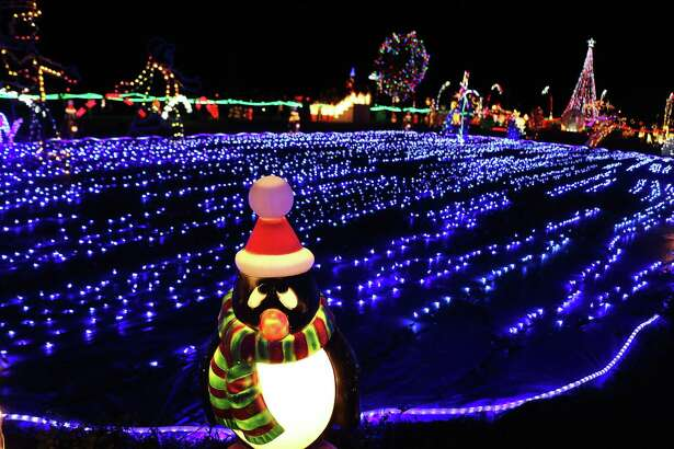 This Christmas display in Dayton has the coolest penguins, a favorite of those who visit the display. There's also a beautiful bridge that crosses over the lake.