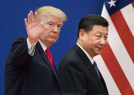 "(FILES) This file picture taken on November 9, 2017, shows US President Donald Trump (L) and China's President Xi Jinping leaving a business leaders event at the Great Hall of the People in Beijing. - Trump said on December 7, 2018, the negotiations to defuse the trade conflict with China are ""going very well."" Trump met Xi during the G-20 summit in Buenos Aires and agreed to a 90-day tariff truce in order to find a more permanent solution to the costly dispute, but messages since have been mixed, roiling global stock markets. ""China talks are going very well!"" Trump tweeted. (Photo by Nicolas ASFOURI / AFP)NICOLAS ASFOURI/AFP/Getty Images"