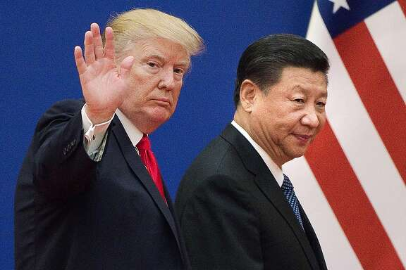 """(FILES) This file picture taken on November 9, 2017, shows US President Donald Trump (L) and China's President Xi Jinping leaving a business leaders event at the Great Hall of the People in Beijing. - Trump said on December 7, 2018, the negotiations to defuse the trade conflict with China are """"going very well."""" Trump met Xi during the G-20 summit in Buenos Aires and agreed to a 90-day tariff truce in order to find a more permanent solution to the costly dispute, but messages since have been mixed, roiling global stock markets. """"China talks are going very well!"""" Trump tweeted. (Photo by Nicolas ASFOURI / AFP)NICOLAS ASFOURI/AFP/Getty Images"""
