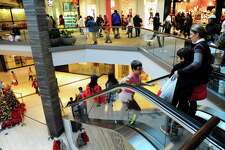 Shoppers look for Black Friday deals at the Westfield Trumbull Mall in Trumbull, Conn. on Friday Nov. 25, 2016.