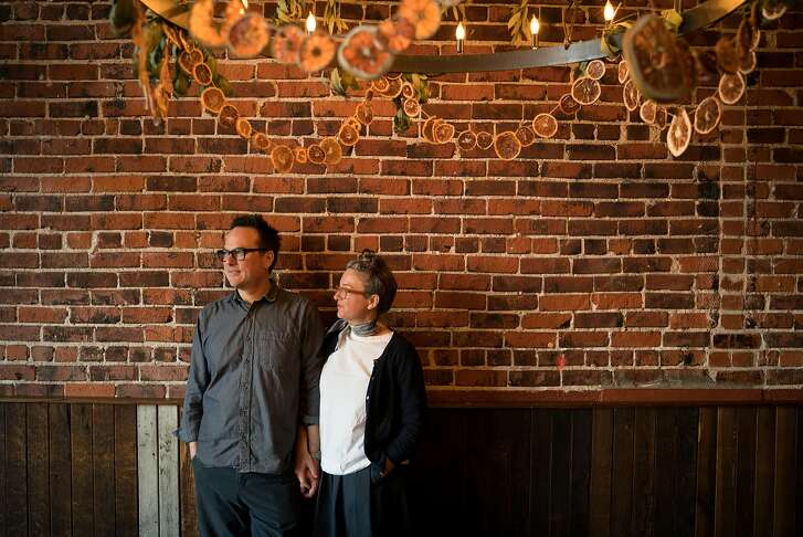 Russell Moore and Allison Hopelain stand for a photo inside of Camino restaurant in Oakland, Calif., on Friday, Dec. 7, 2018.  Moore and Hopelain have been co-owners of Camino for over ten years.