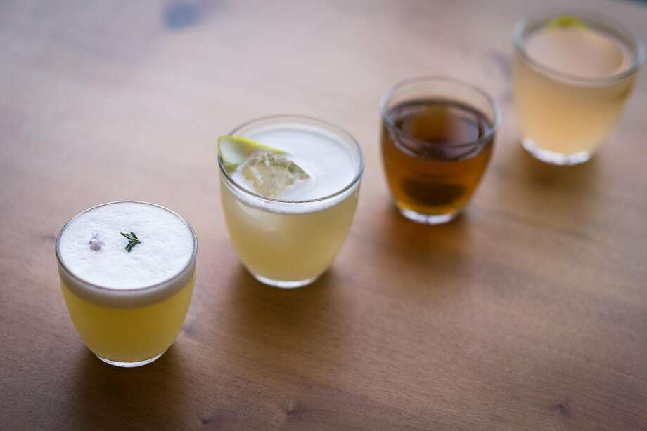 The beautiful, understated Camino cocktails. From left: mezcal cocktail, mai tai, rye manhattan and hot toddy. Photo: Sarahbeth Maney / Special To The Chronicle