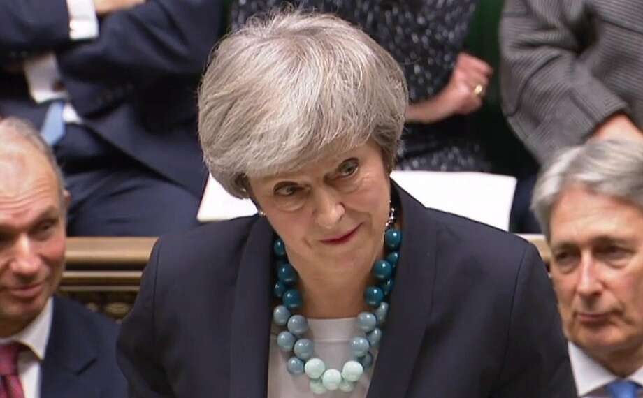 British Prime Minister Theresa May addresses members Parliament in London. She says she will go back to European Union leaders to seek changes to the divorce agreement. Photo: AFP / Getty Images