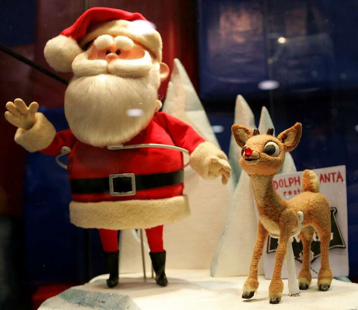 """Original Santa Claus and Rudolph puppets from the TV special """"Rudolph the Red Nosed Reindeer,"""" are seen on display at the Time and Space Toys booth during the Mid-Ohio-Con comic book convention in Columbus, Ohio, Sunday, Nov. 25, 2007. Kevin Kriess, owner of the Pittsburgh, Penn., store found the puppets and had them restored after they were used as toys. (AP Photo/Paul Vernon)"""