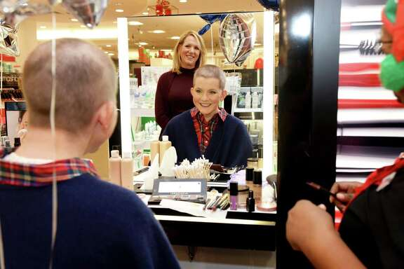 17-year-old wish kid Claire and her mother Donna Wright smile following Claire's makeover done as part of a Phantom of the Opera-themed wish enhancement experience provided by Macy's and Make-A-Wish at Macy's Memorial City on Friday, Dec. 7, in Houston.