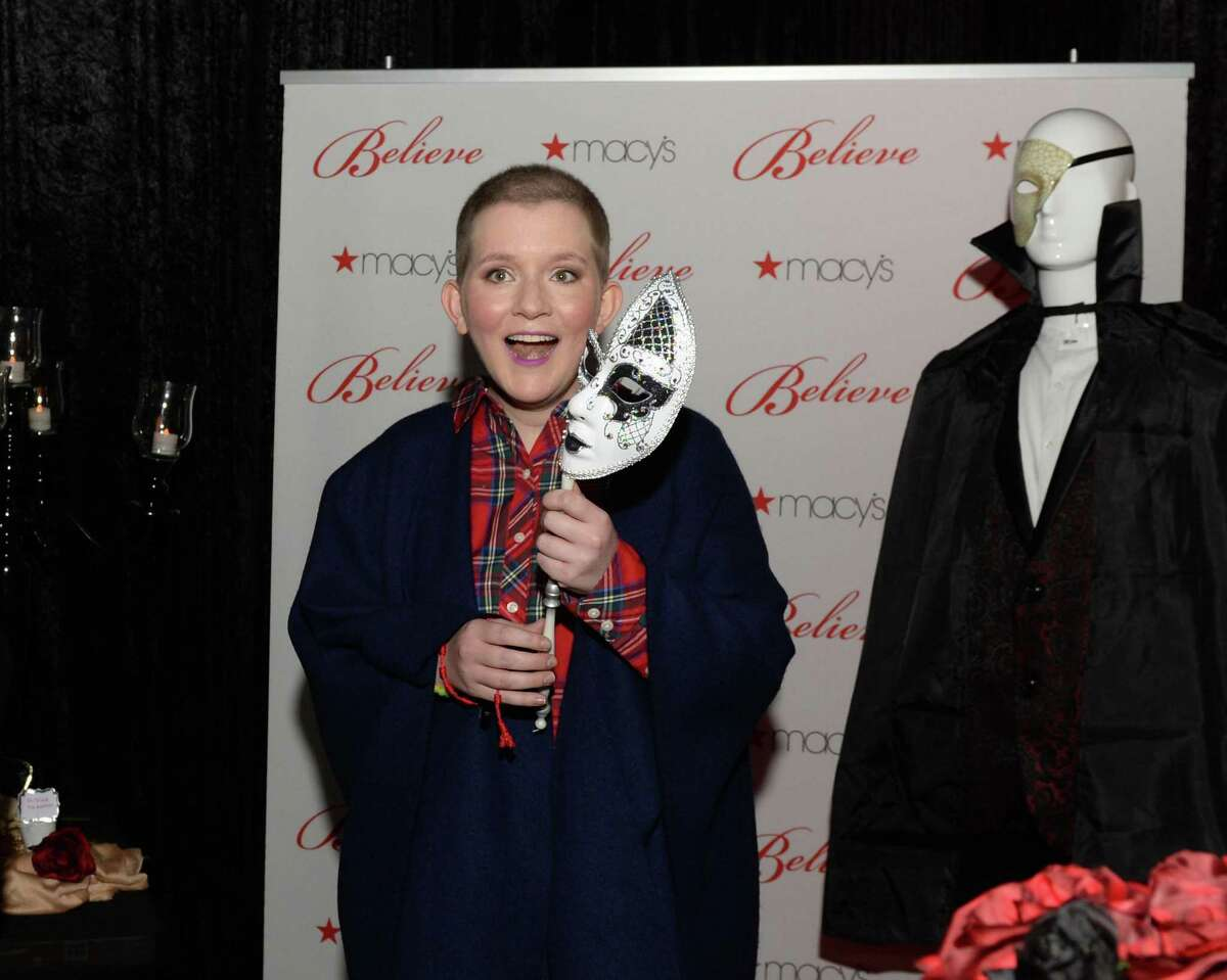 """17-year-old wish kid Claire reacts with surprise as she enters a """"Phantom of the Opera""""-themed party room provided by Macy's and Make-A-Wish at Macy's Memorial City on Friday, Dec. 7, in Houston."""