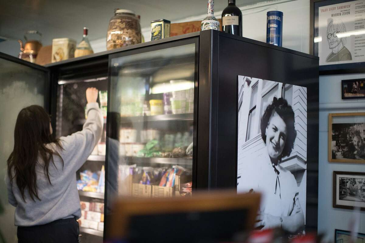 A portrait of Penelope Zouzounis, who founded the store with husband Theodore at Ted's Market displayed a refrigerator on Friday, Dec. 7, 2018, in San Francisco, Calif.