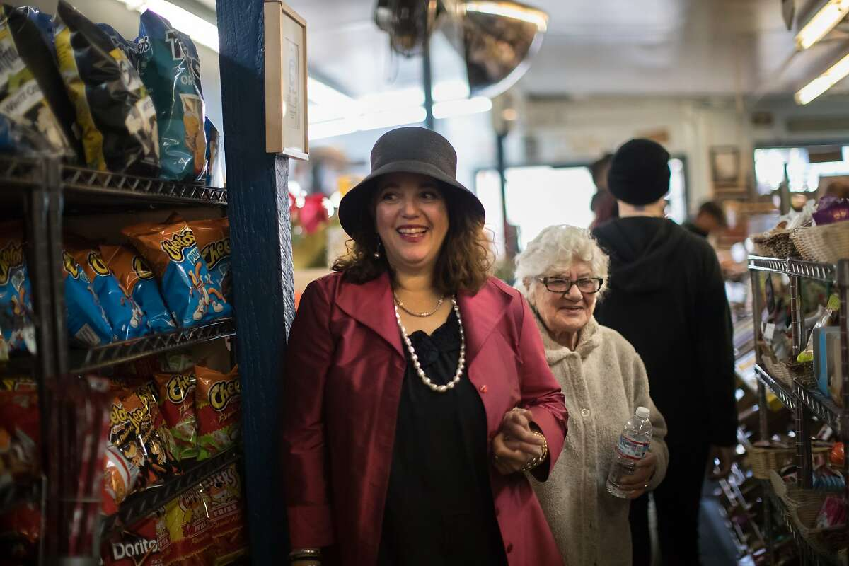 Lorene Zarou-Zouzounis introduces her mom, Salimeh Zarou, 86, to employees at Ted's Market for on Friday, Dec. 7, 2018, in San Francisco, Calif.