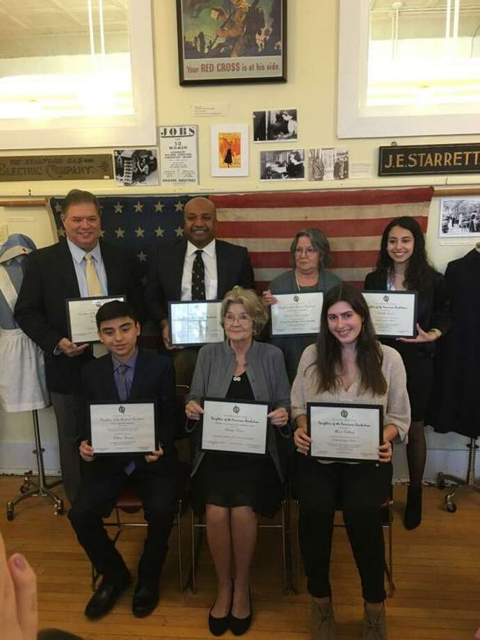 Pictured accepting their awards from the Stamford D.A.R. at the Stamford Community Awards Ceremony are: William Herrera, Christine Varner, Alysa Goldberg, (back row) Jean Alverez accepting for his son Tommy Alverez, Sharad Samy, and Isabella Sorial. Photo: Contributed Photo / Contributed Photo / Stamford Advocate  contributed
