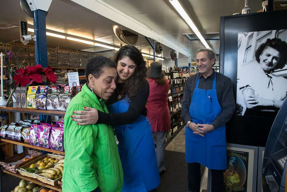Bonita Abram (left), a regular at Ted's Corner Store, hugs Miriam Zouzounis, whose parents own the SoMa grocery. Photo: Paul Kuroda / Special To The Chronicle
