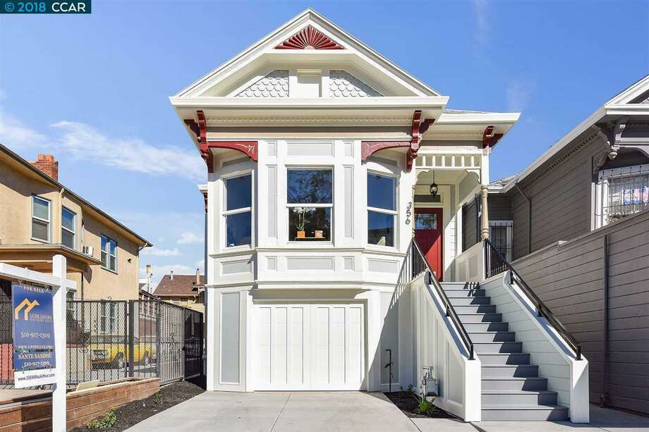 Centrally located can be a plus and a minus: this restored Oakland home asking $995K shows us both. Photo: Open Homes Photography