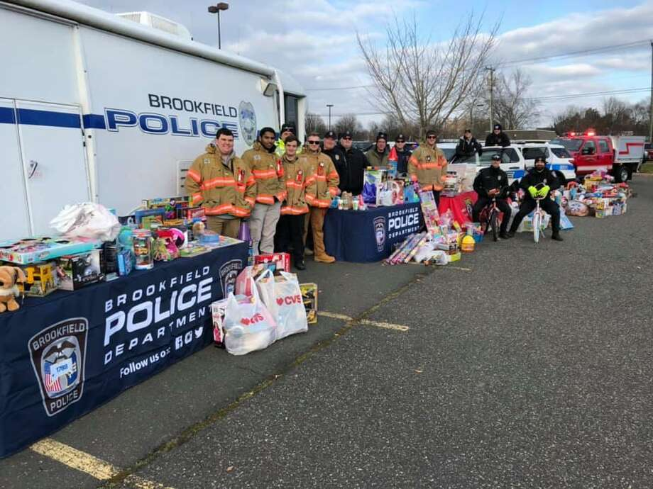 The police department collected toys during its fourth annual Stuff a Cruiser drive on Saturday at the Raymour and Flanigan Plaza Photo: / Brookfield Police Department Facebook /Contributed Photo