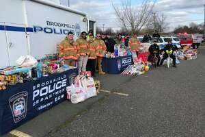 The police department collected toys during its fourth annual Stuff a Cruiser drive on Saturday at the Raymour and Flanigan Plaza