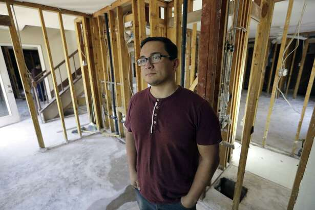 Jacob Lerma poses inside his home, which was damaged by floodwaters from Hurricane Harvey, in January, five months after the storm. The city of Friendswood is staging a Dec. 17 information meeting for those still in need of recovery from the storm. The meeting will be at 6:30 p.m. that day at Friendswood City Hall, 910 S. Friendswood Drive