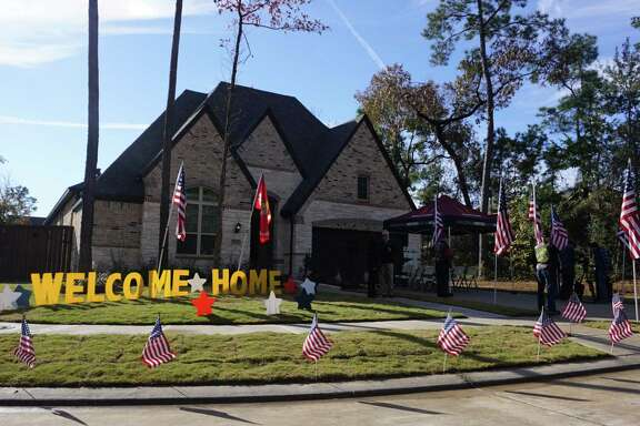 Among those at the celebration of the Byrnes' new house include members of the Atascocita Fire Department, Patriot Guard Riders motorcycle club and The Groves community.