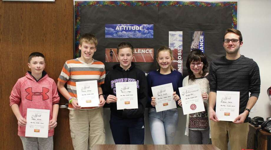 "Har-Bur Middle School recently recognized 8th-graders Nicholas Atkins, Kaitlyn Bell, Patrick O'Regan, Mimi Shellito, Gabby Sliwka, and 7th grader Nathan Misluk as the honorees for the 2019 Prudential Spirit of Community Awards, which ""celebrates the spirit of youth volunteer service and recognizes students who have distinguished themselves by making a meaningful difference in their communities by volunteering,"" according to a statement. These six students are members of Har-Bur's community service group Kids In The Middle (KIM). In addition, Kaitlyn Bell was nominated for state-level recognition for the President's Volunteer Service Award. She becomes eligible to win an unrestricted award of $1,000 or more and a paid trip to Washington D.C. Winners will be announced Feb. 5. Above, from left, are Nathan Misluk, Nicholas Atkins, Patrick O'Regan, Gabby Sliwka, Kaitlyn Bell and coordinator Jim Mann, holding the certificate for Mimi Shellito who was absent. Photo: Contributed Photo"
